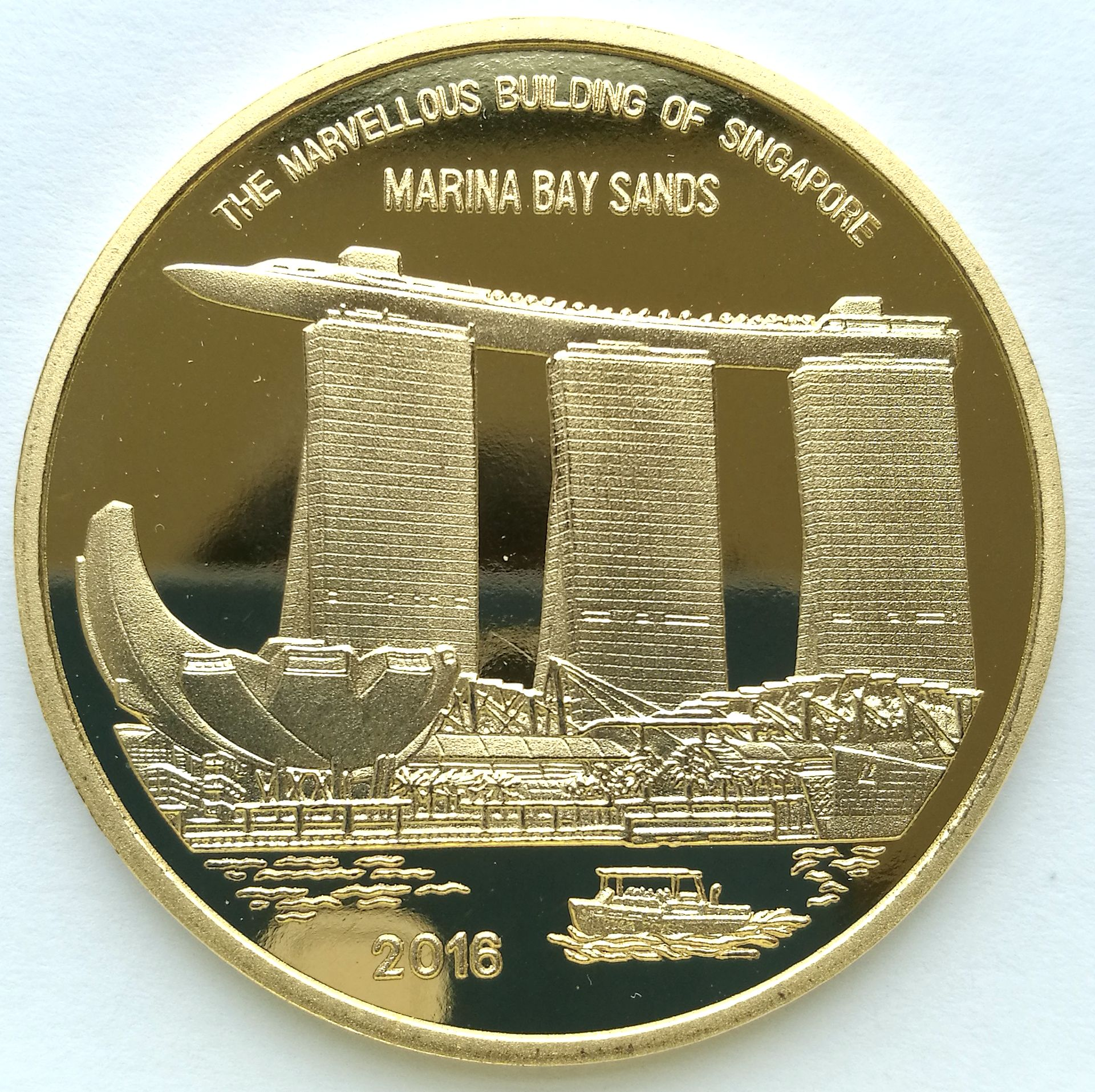 "L3195, Korea ""Marina Bay Sands"" Singapore Fair Brass Coin 5 Won. 2016"